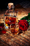 Cognac with red rose Royalty Free Stock Photo