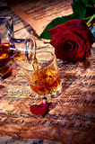 Cognac with red rose Stock Photography