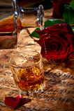 Cognac with red rose Royalty Free Stock Image