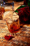 Cognac with red rose Royalty Free Stock Photos