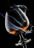 Cognac in rook royalty-vrije stock foto's