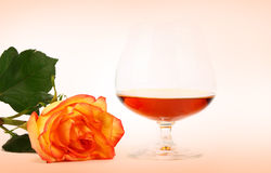 Cognac and rose Royalty Free Stock Photography