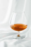 Cognac on satin Royalty Free Stock Image