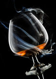 Cognac in smoke Royalty Free Stock Photos