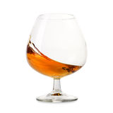 Cognac splashes in a glass Royalty Free Stock Photos