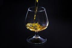 Cognac in un vetro Immagine Stock