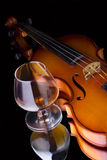 Cognac and violin Royalty Free Stock Image
