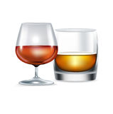 Cognac and whiskey glasses isolated Stock Photo