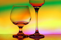 Cognac and wineglass. Silhouetted cognac and wineglass isolated on elegant Royalty Free Stock Images