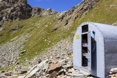 COGNE, ITALY - AUGUST 22, 2014: Alpine bivouac Franco Nebbia situated in the tall Arpisson walloon. Stock Images