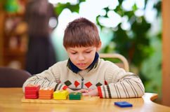 Cognitive development of kids with disabilities Stock Images
