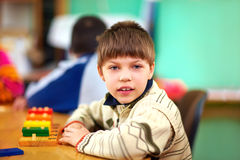 Cognitive development of young kid with disabilities Royalty Free Stock Image