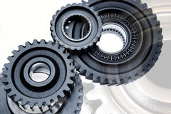 Cogs. Close-up of multiple steel cogs Stock Image