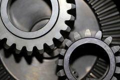 Cogs. Close up of cog wheels against dark background Stock Photo