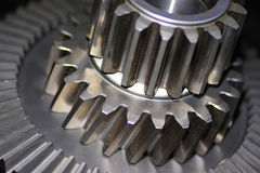 Cogs. Close up of cog wheels against dark background Royalty Free Stock Images