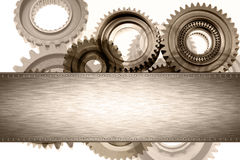 Cogs. Steel panel on cogs. Copy space Royalty Free Stock Image