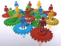 Cogs + 3D figures as a metaphor for a diverse team. Model of 3D figures on connected cogs as a metaphor for a team - emphasis on diversity Royalty Free Stock Photos