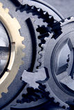 Cogs. The metal cogs in bluish royalty free stock photo
