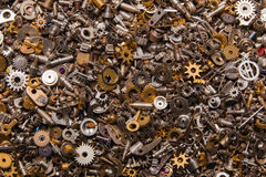 Cogs background. A macro shot of a lot of cogs and wheels and other clock parts filling the frame completely stock photos