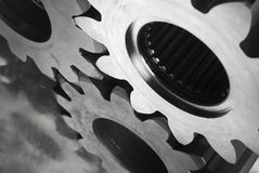 Cogs in black/white. Three cogs, gears against stainless-steel, close-up Stock Photography