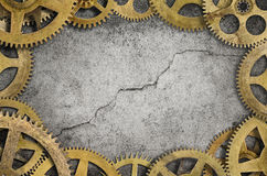 Cogs Border. Old clock cogs border and cracked wall background stock photography