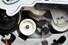 Cogs and drive in electronic equipment. Royalty Free Stock Photography