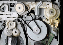 Cogs and drive in electronic equipment. Stock Photo