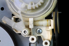 Cogs and drive in electronic equipment. Royalty Free Stock Images
