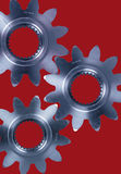 Cogs and gears. Cogs gears against red backdrop Royalty Free Stock Images