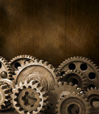 Cogs Gears Brown Background. A montage of industrial cogs or gears with a warm tone and rustic background with space for type royalty free stock photo