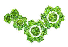 Cogs or gears from green grass isolated Royalty Free Stock Image