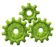Cogs or gears from the green grass. Stock Photo