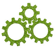 Cogs or gears from the green grass. Stock Photography