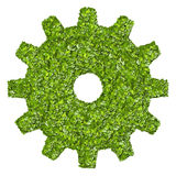 Cogs or gears from the green grass. Stock Images