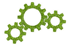 Cogs or gears from the green grass. Royalty Free Stock Photo