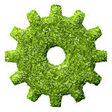 Cogs or gears from the green grass. Stock Photos