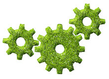 Cogs or gears from the green grass. Royalty Free Stock Photos