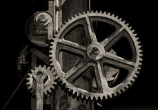 Cogs and gears of machine Stock Images