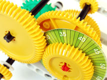 Cogs and gears system. An arrangement of interlocking gears, assembled to show how a simple gear system or wheel and axle system, works.  Brightly coloured Stock Image