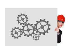 Cogs and gears. Woman engineer holding poster with cogs and gears Royalty Free Stock Images