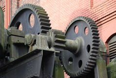 Cogs. Large cogs providing the gearing to move bessemer pig iron converter Royalty Free Stock Image