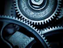 Cogs in a machine. Cog and wheel details from machines of the industrial revolution Stock Image