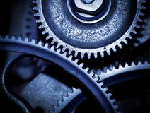 Cogs in a machine. Cog and wheel details from machines of the industrial revolution Stock Images