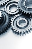 Cogs. Metal cog wheels bonding together Stock Photography