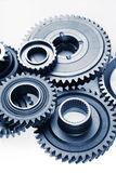 Cogs. Metal cog wheels bonding together Stock Photo