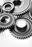 Cogs. Metal cog wheels bonding together Stock Photos