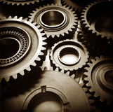 Cogs. Metal cog wheels bonding together Royalty Free Stock Photos