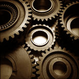 Cogs. Metal cog wheels bonding together Royalty Free Stock Image