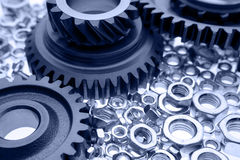 Cogs and nuts Stock Image