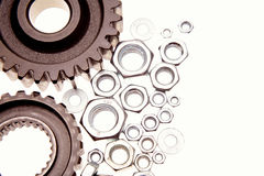 Cogs and nuts Royalty Free Stock Image